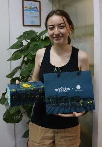 Kohanna Wilson with a mooncake package she developed while on an internship at G.O.D this summer